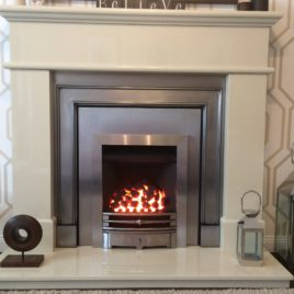 54″ Pisa fireplace in marfil stone complete with london fronts and gazco gas convector