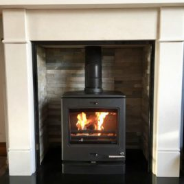 Limestone Fireplace package complete with Yeoman 5kw stove