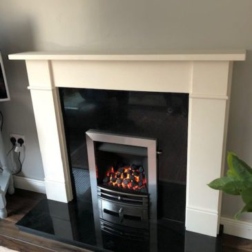 Recently installed Limestone Fireplace granite inset & hearth with a Gazco Logic convector gas fire