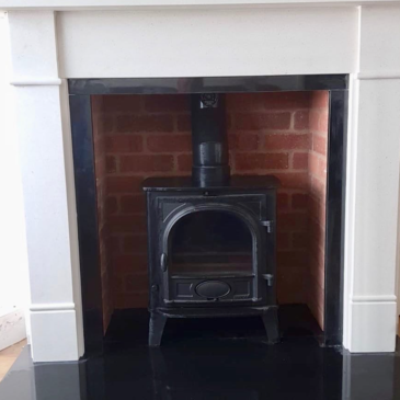 Recently installed Limestone surround rustic brick chamber Stovax stove in Lisburn