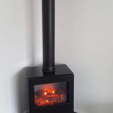 Recent installation in Lisburn of Gazco Riva Vision's electric stove with custom made corner granite hearth