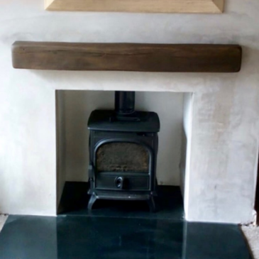 Recently installed Dovre 250 stove with granite hearths & beam